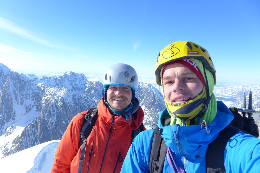 Miha Zupin and Janez Svoljšak on top of Apocalypse North (ca 9,020') after making the first ascent of the Slovenian Route (1300m, AI4+ R M6 80˚), as well as the first ascent of the peak.