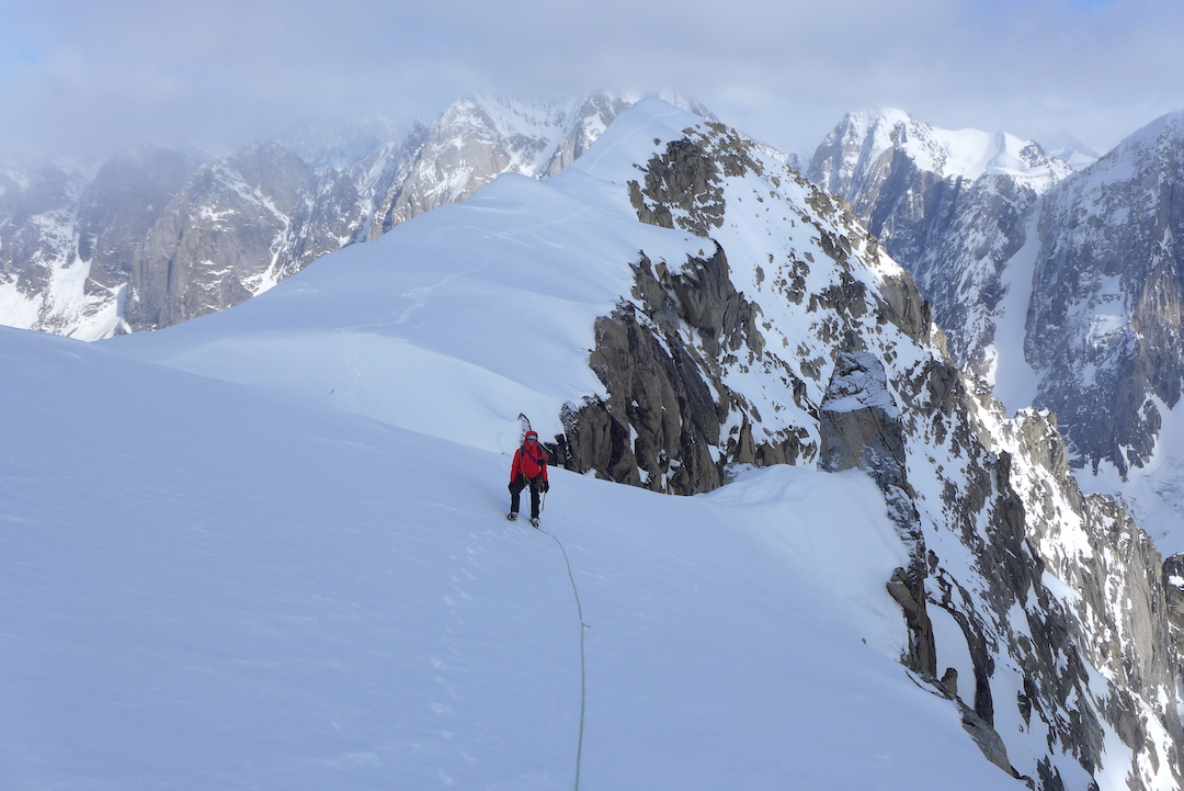Miha Zupin traversing the summit ridge to the top of Seraph (8,540') during the first ascent of the Last Supper for Snow Strugglers (700m, M7 80˚).