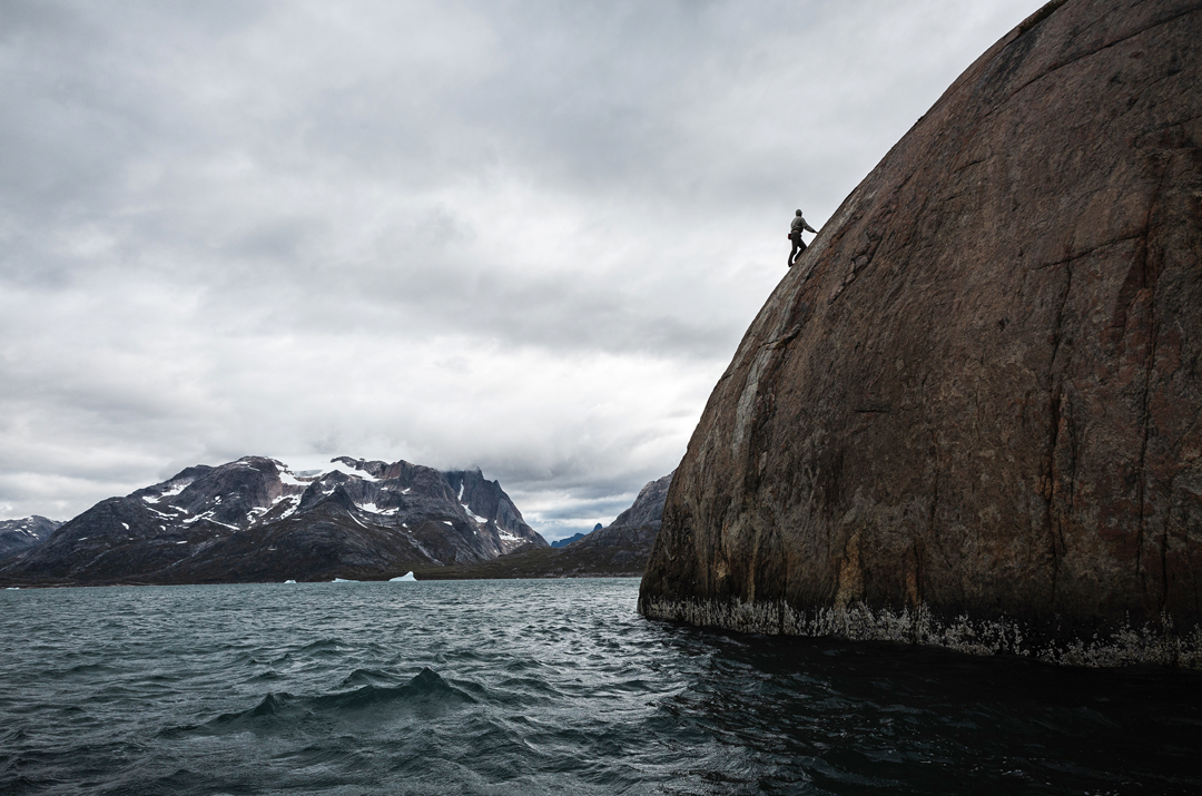 Charlie Long soloing a little bluff right outside the harbor at Aappilattoq, Torssukatak Fjord.