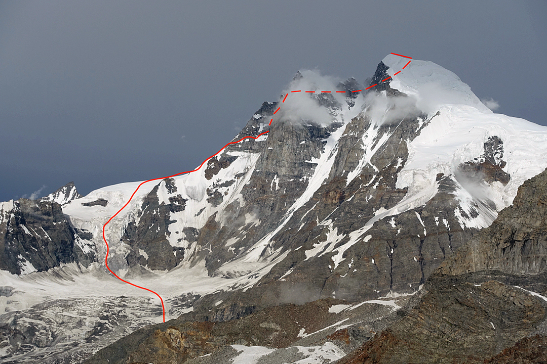 Menthosa from the east-southeast showing the American route up the south ridge. Their descent, and the standard route up the mountain, follows the snow slopes on the right side of the image.