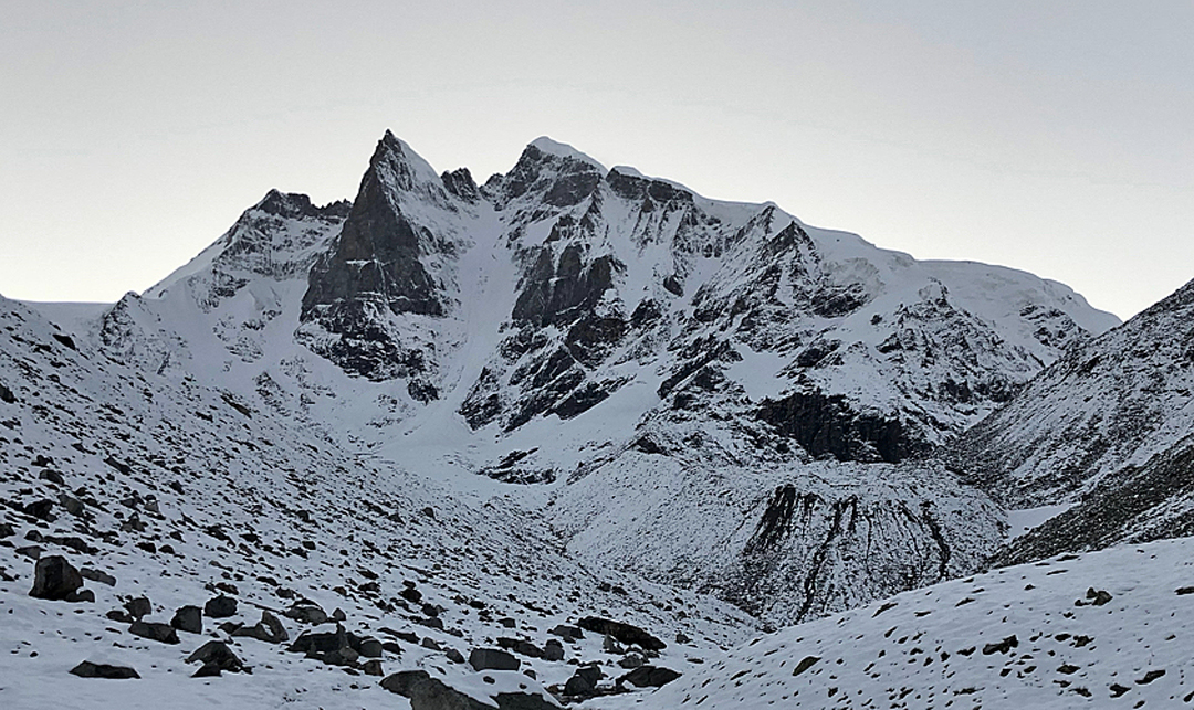 Menthosa from base camp to the southeast, with the prominent triangular southeast pillar on the left.
