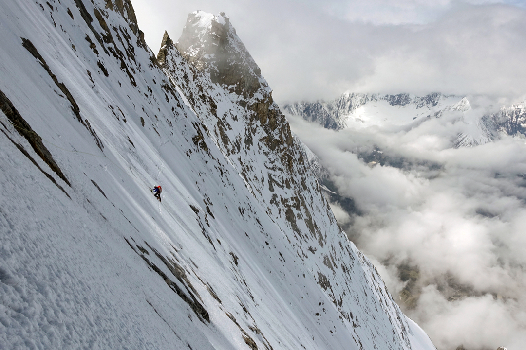 Rushad Nanavatty traversing the west flank of Menthosa's south ridge during the first ascent.