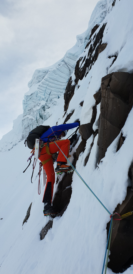 Ascending steep snow and mixed climbing on Via Pirenaica, south face of Nevado Concha de Caracol.