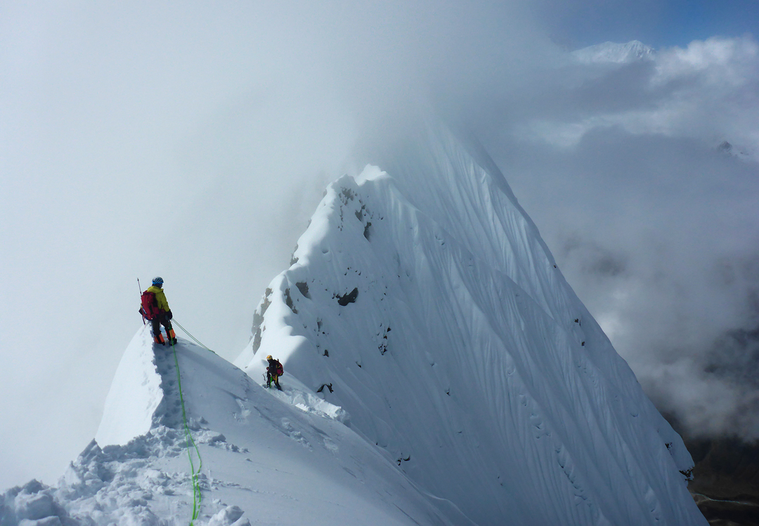 "Starting the crux ""blade traverse"" at 6,520m, heading toward the summit of Panpoche I."