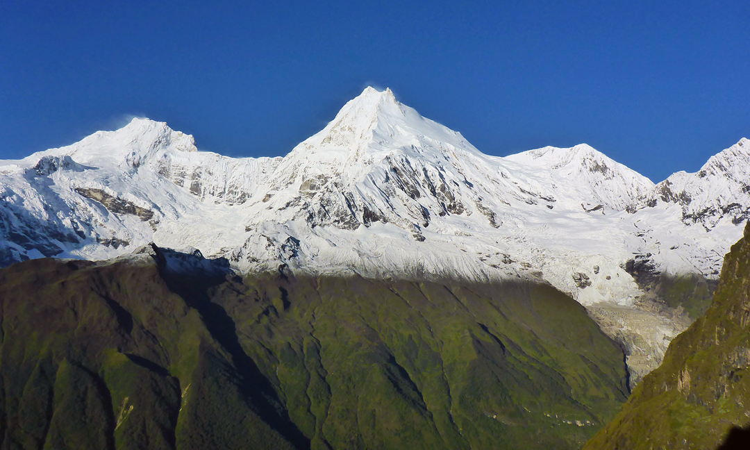 Looking southeast from day one on the southwest ridge of Panpoche II. From left to right: Ngadi Chuli (7,871m), Manaslu (8,163m), and Manaslu North (7,175m).