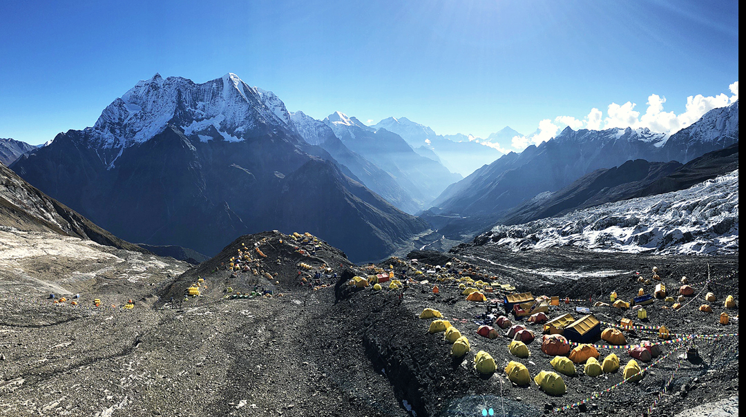 The Panpoche peaks from Manaslu Base Camp: Panpoche I is the triangular rock pinnacle toward the left end of the ridge; Panpoche II is the snow dome at the right end.