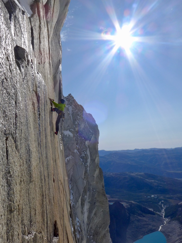 Luka Lindič leading a sheer face below the serious overhangs on Mir, south face of Aguja St. Exupery.