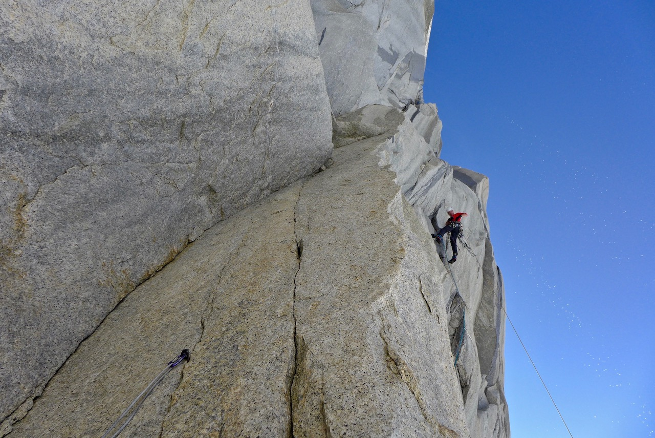 Luka Krajnc aids a steep seam on Mir, south face of St. Exupery.