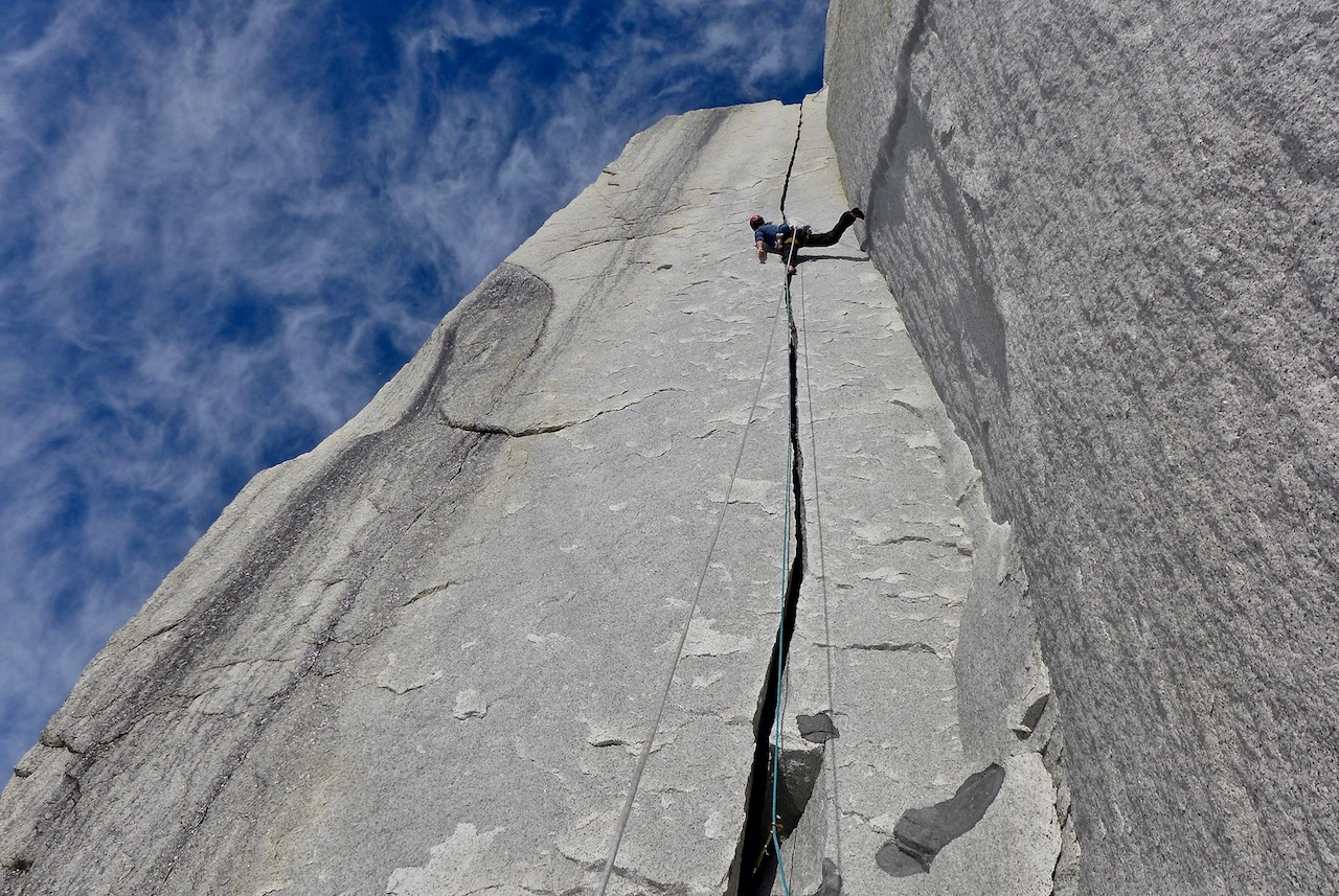 Luka Lindič leads up an impeccable jam crack high on the wall on Le Petit Prince, south face of St. Exupery.