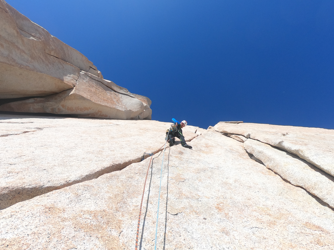 Ascending the beautiful cracks of 40° Gruppo Ragni on the first free ascent.