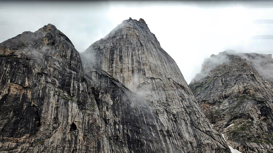 The northeast face of Sergey Glazunov Peak, climbed solo via a line on the far side of the right edge by Evgeny Glazunov.