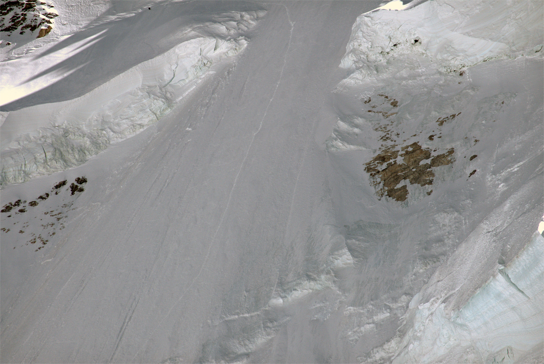 Ascent tracks on the lower northeast face of Gasherbrum VII. The small dot close to the top of the picture and above the left-hand serac barrier is Francesco Cassardo, who is just starting his ski traverse across the top of the barrier before attempting to turn down the tracks.