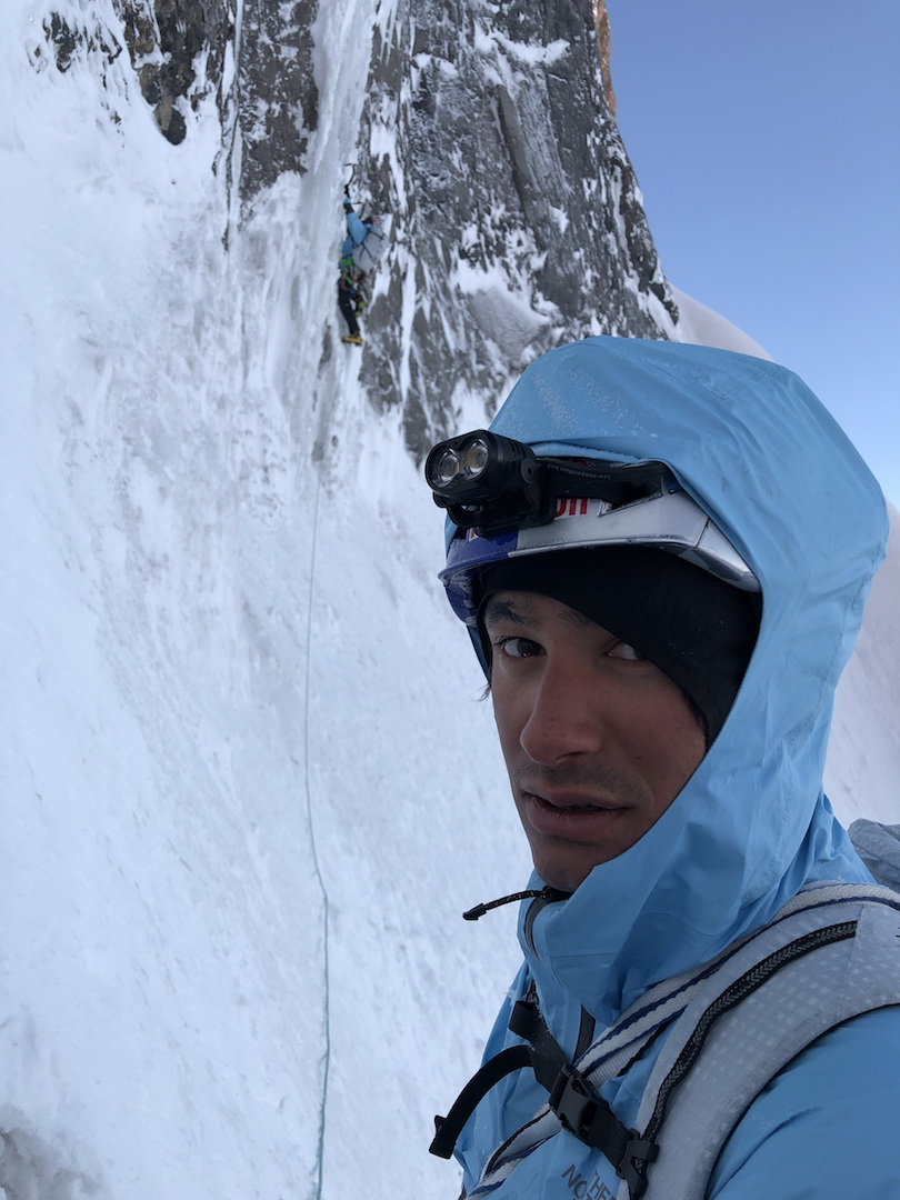 David Lama belaying Hansjörg Auer on a steep ice pitch on Howse Peak.