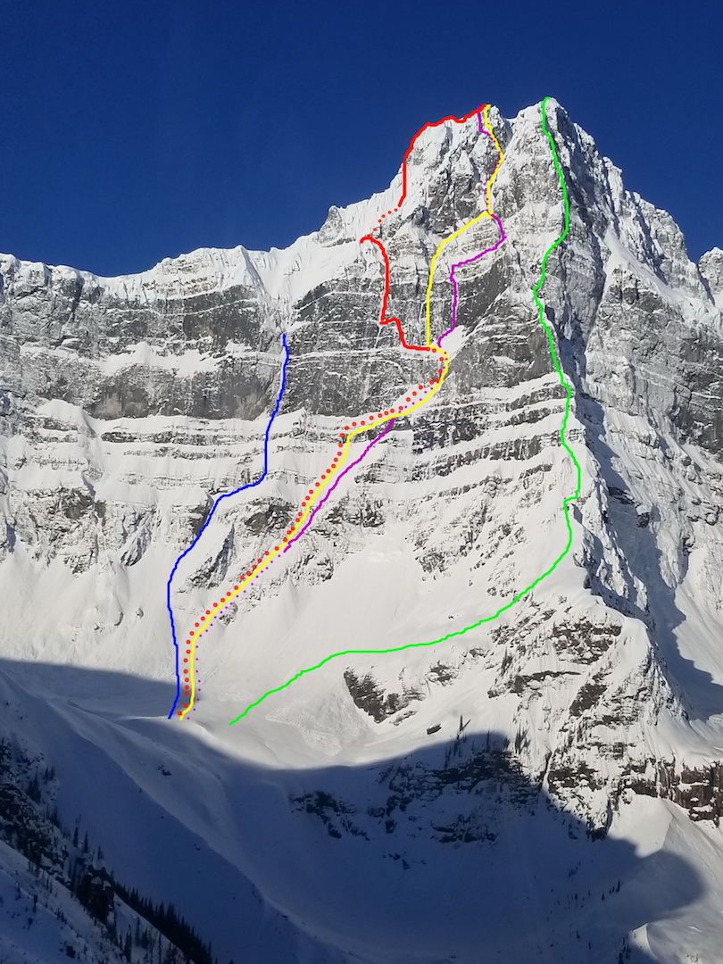 The east side of Howse Peak in the Canadian Rockies. Blue: Life by the Drop (1999). Red: Auer-Lama-Roskelley Line (2019). Yellow: M16 (1999). Purple: Howse of Cards (2002). Green: Northeast Buttress (1967). Parks Canada