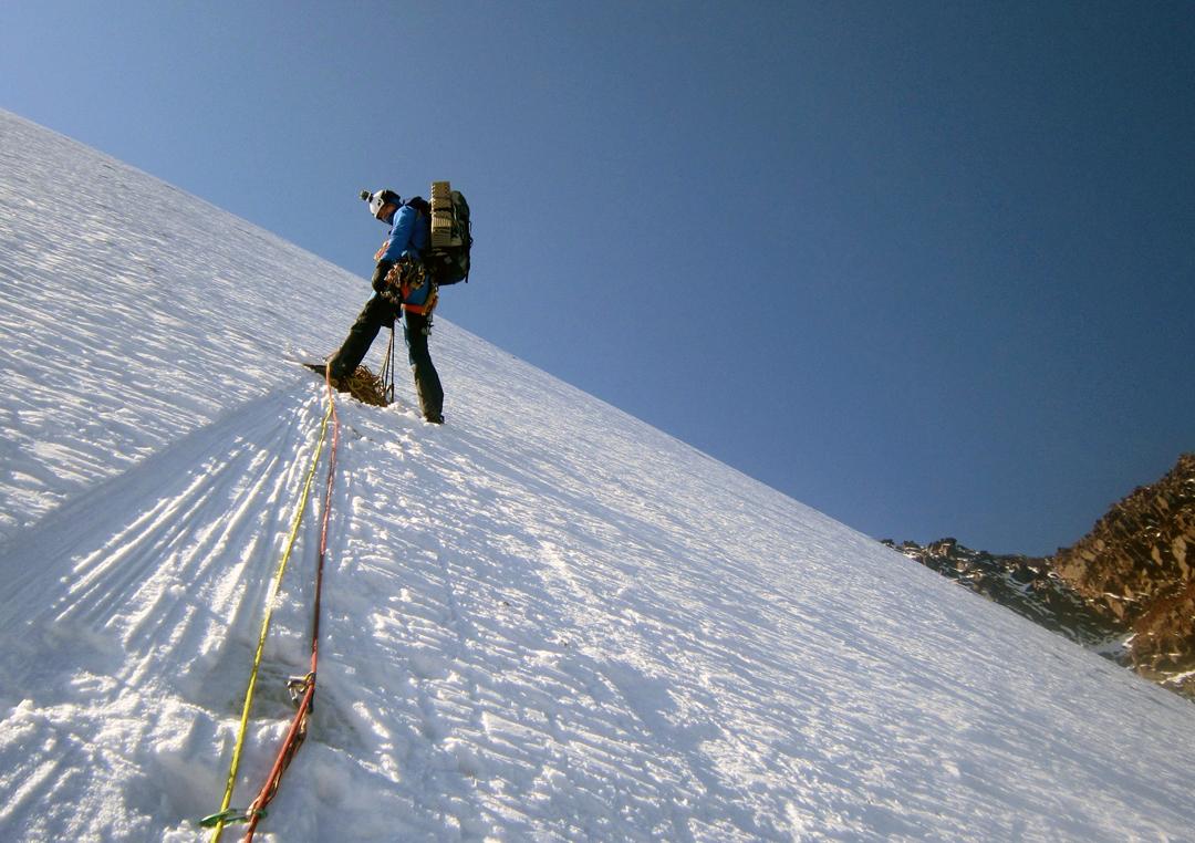 Maciej Nieścioruk on the initial ice wall leading to the west ridge of Pik Kөпөлөк (Pik Butterfly).