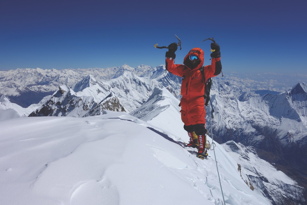 Yannick Graziani celebrates on the summit of Annapurna after an eight-day alpine-style ascent of the south face with Stéphane Benoist. The two exited the face to the east of the summit, beyond the C1 point visible in the distance along the summit ridge, then plodded to the top. To be certain he reached the highest point, Graziani continued to C3 West, then returned to this point to start the long descent.