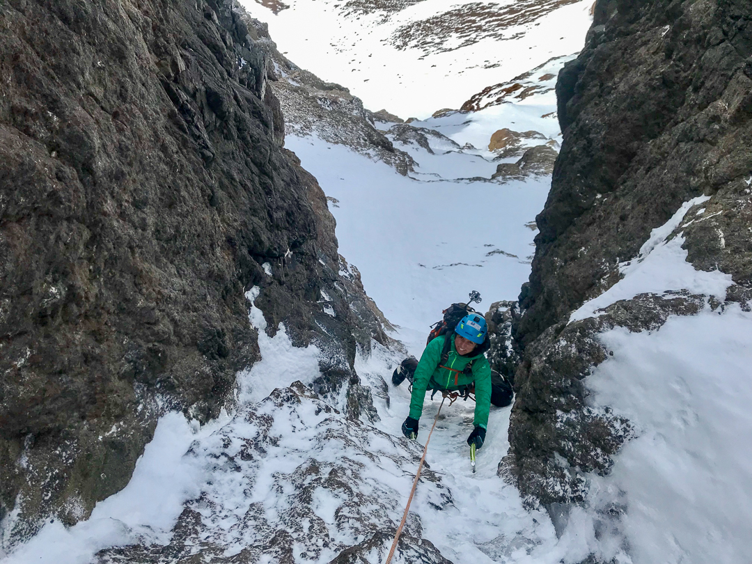 Antonia Aldunate seconding the second of two runnel pitches on Corta Corriente (800m, WI5) on the south face of Cerro Redondo.
