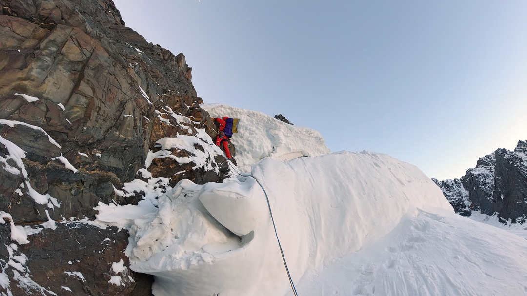Siyuan Huang surmounts the bergschrund on the northwest face of Daddomain West.