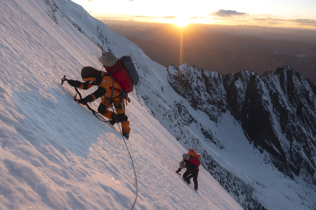 Yuikeung Ho and Xiaohua Yang approach the shoulder on the upper north ridge of Daddomain West during the second day of the climb.