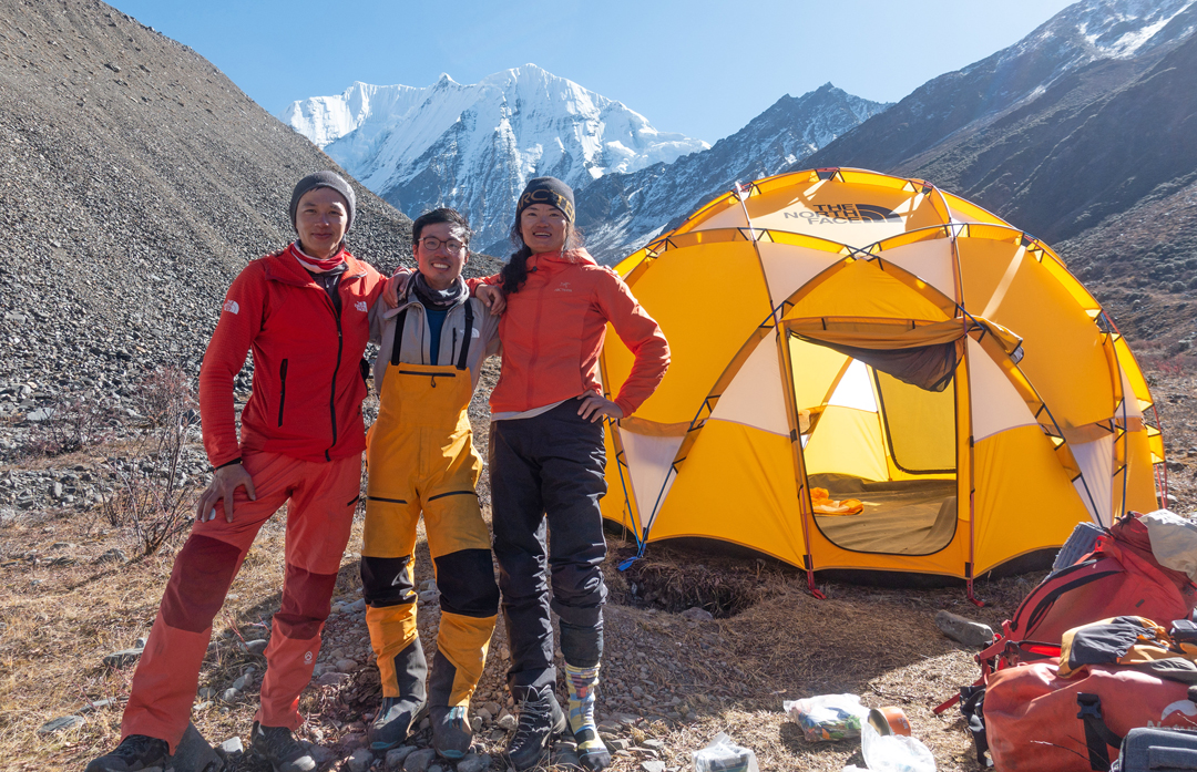 From left to right: Siyuan (Azuo) Huang, Yuikeung (Kenneth) Ho, and Xiaohua (Charlotte) Yang at base camp in the Moxi Valley with the northwest side of Daddomain behind.