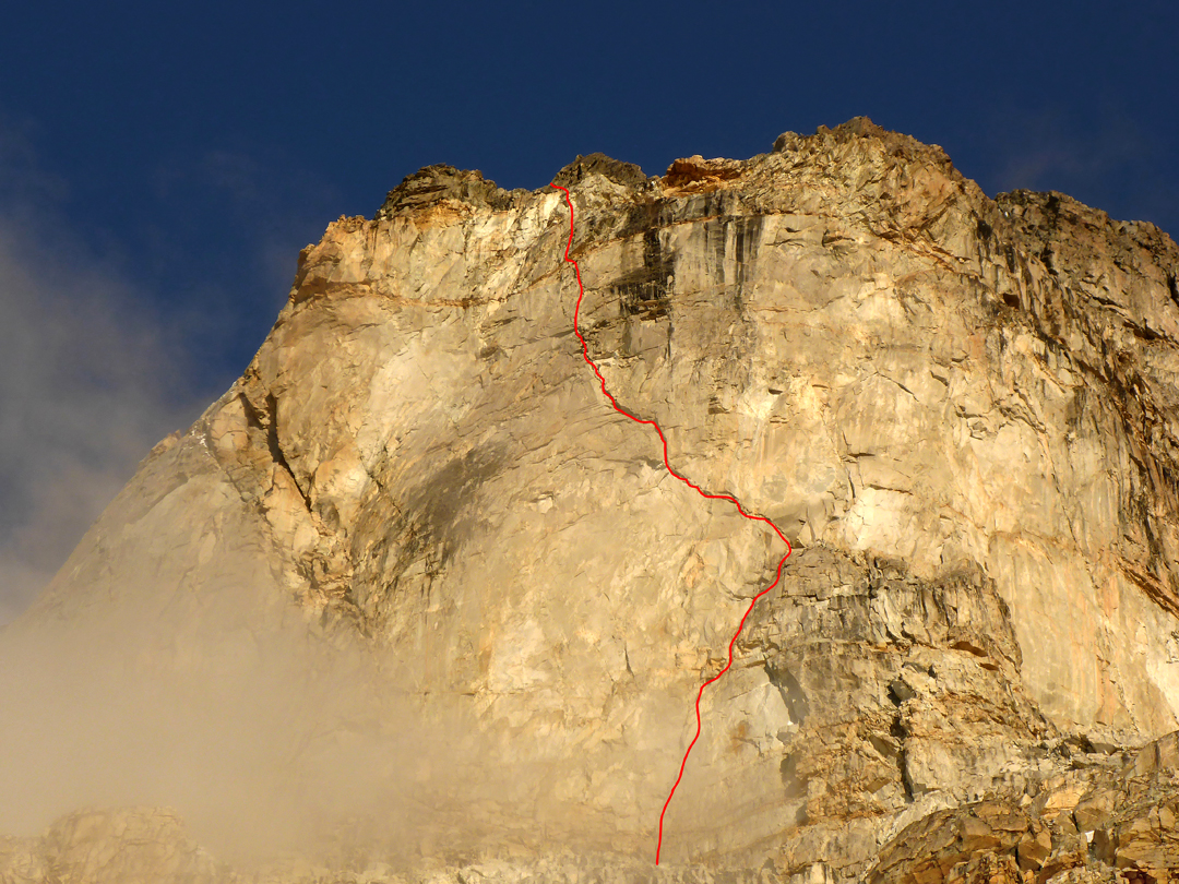 The upper rock barrier and crux of the new Georgian Route on the northwest face of Ushba South.