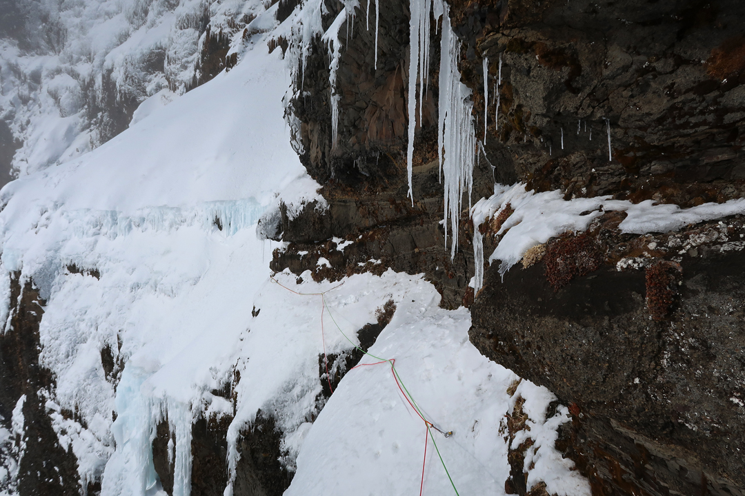 The sketchy traverse to the second snowfield of End of the Line, southeast face of Skarðatindur.