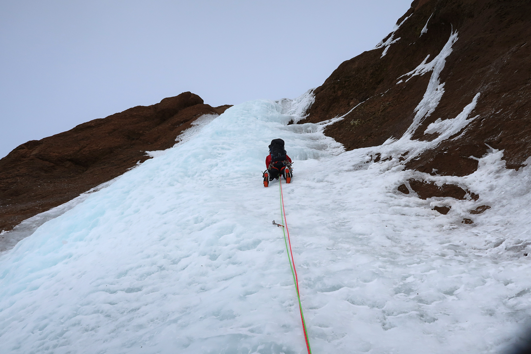 Rory Harrison on the last pitch of the initial 180m icefall on End of the Line, southeast face of Skarðatindur.
