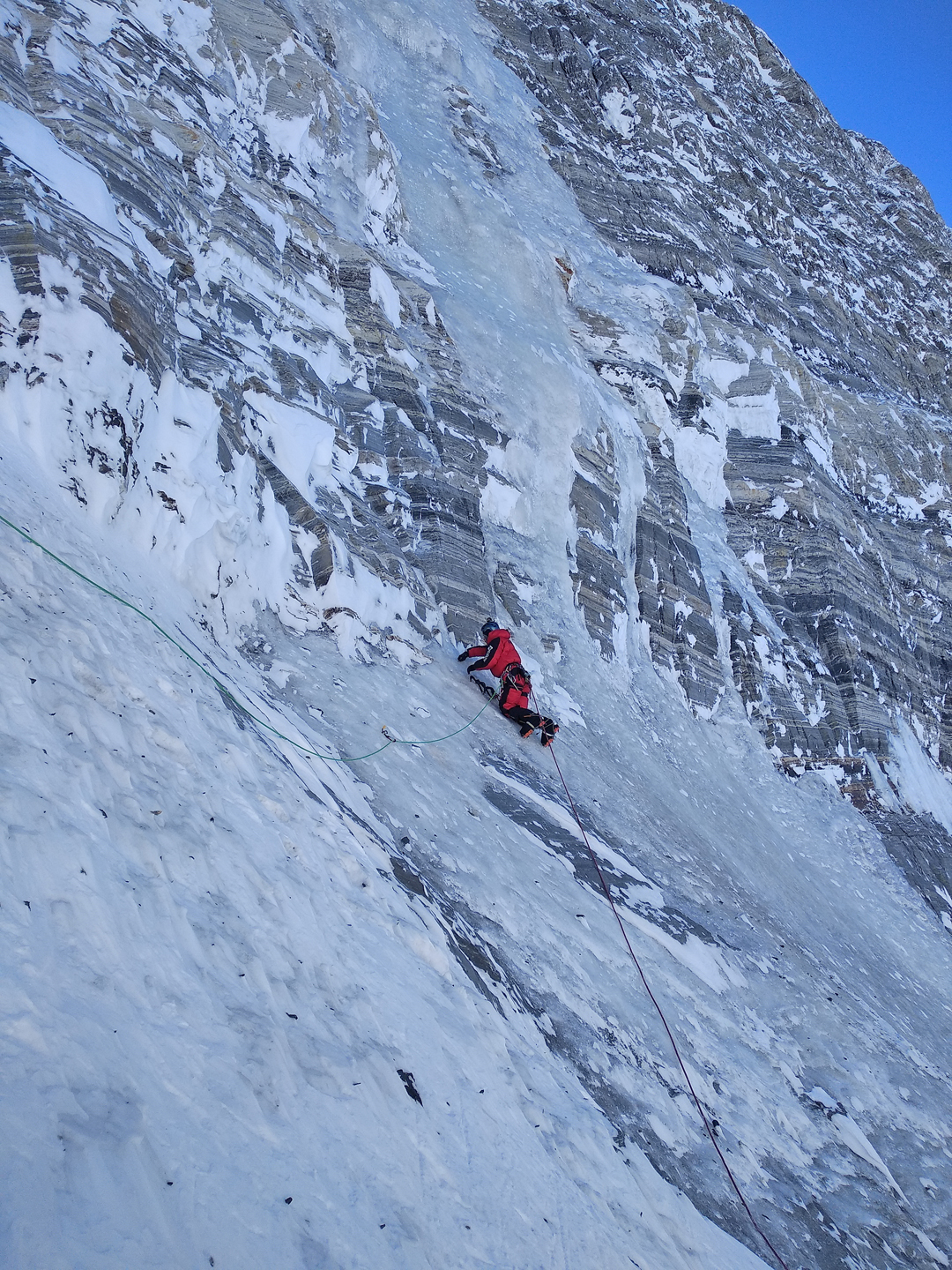 Approaching a steep section of bulletproof winter ice on the lower north face of Pik Communism.