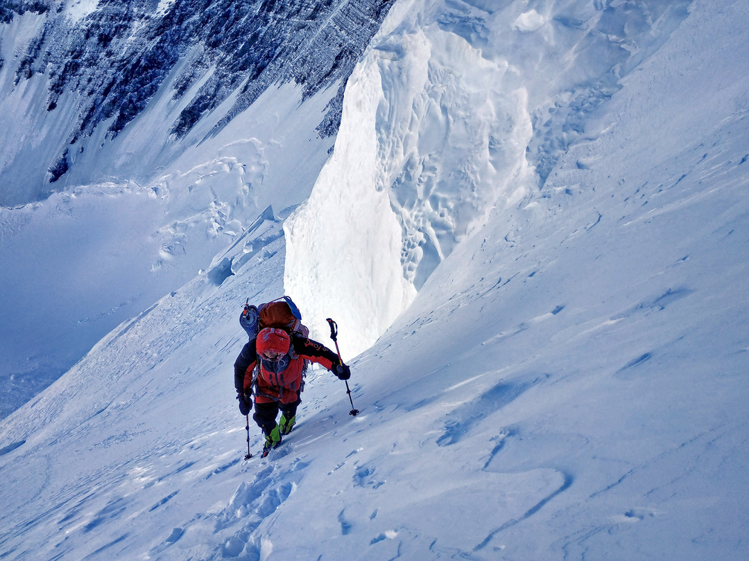 Moving unroped on the upper slopes of the north face of Pik Dushanbe.