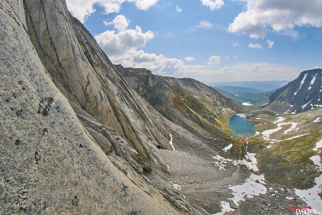 Looking across the granite slabs and walls on the west face of Pik Kart to the approach valley coming up from the south.