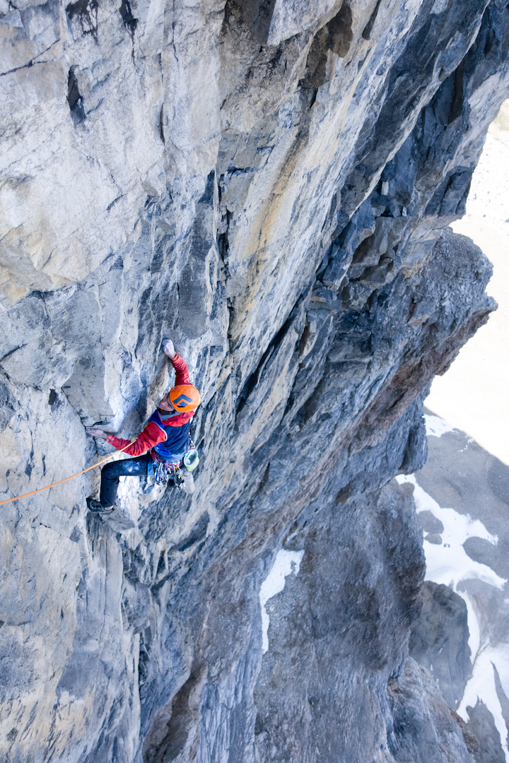 Tony McLane follows the upper crux of The Hammer and the Dance (750m, 5.11c) on the northeast face of Neptuak Mountain. His and Harrington's route is the first summer rock climb to ascend the face.