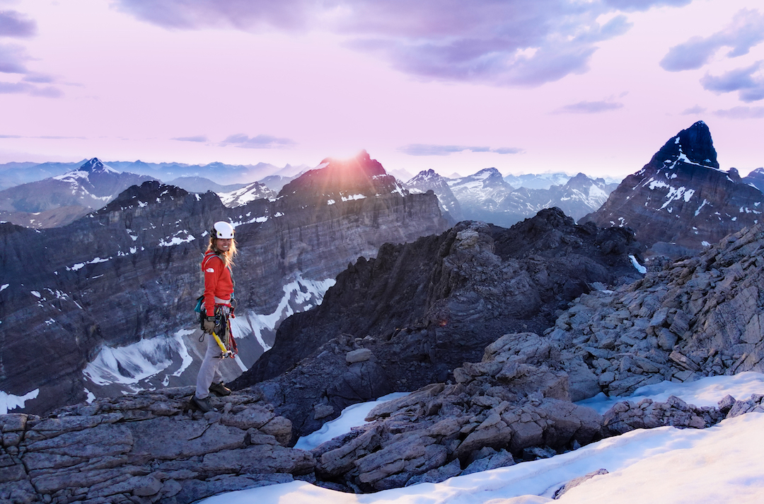 Brette Harrington takes in an unreal sunset from atop the northeast face of Neptuak Mountain in The Valley of the Ten Peaks, following her and Tony McLane's climb of The Hammer and the Dance (750m, 5.11c).