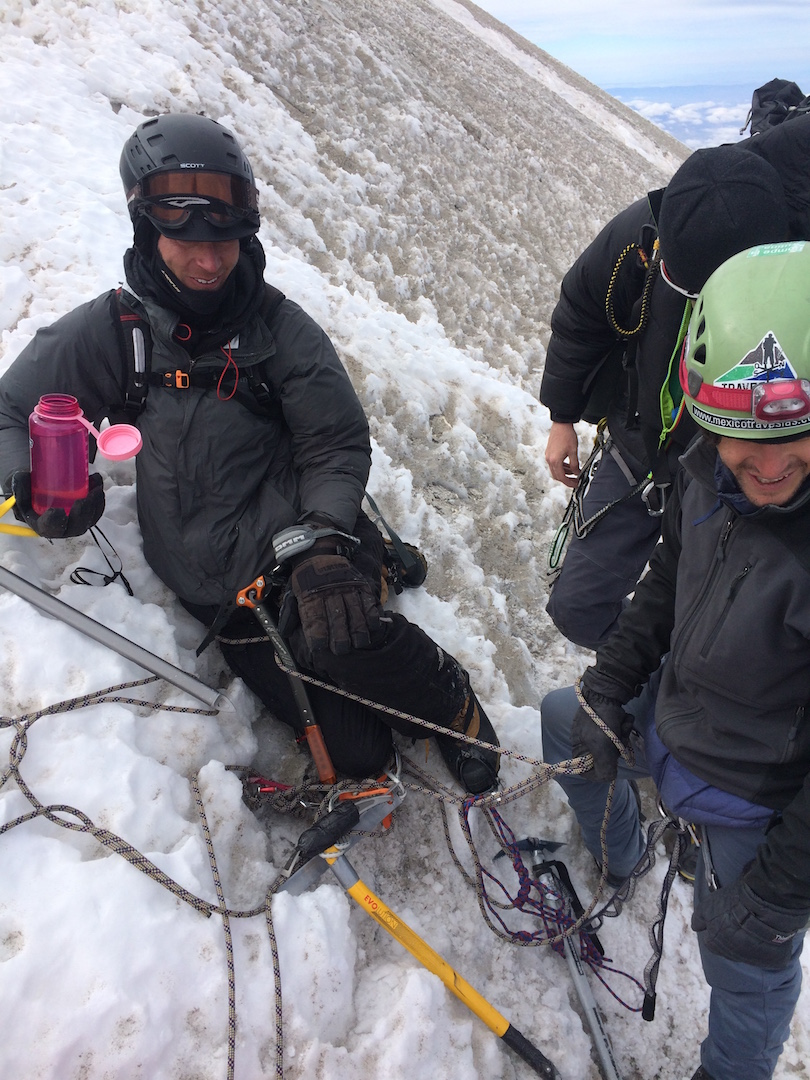 Jake Lloyd relaxes with his rescuers after more than 24 hours inside a crevasse on Pico de Orizaba. Carlos Romay (green helmet) found Lloyd in the crevasse and led the rescue.