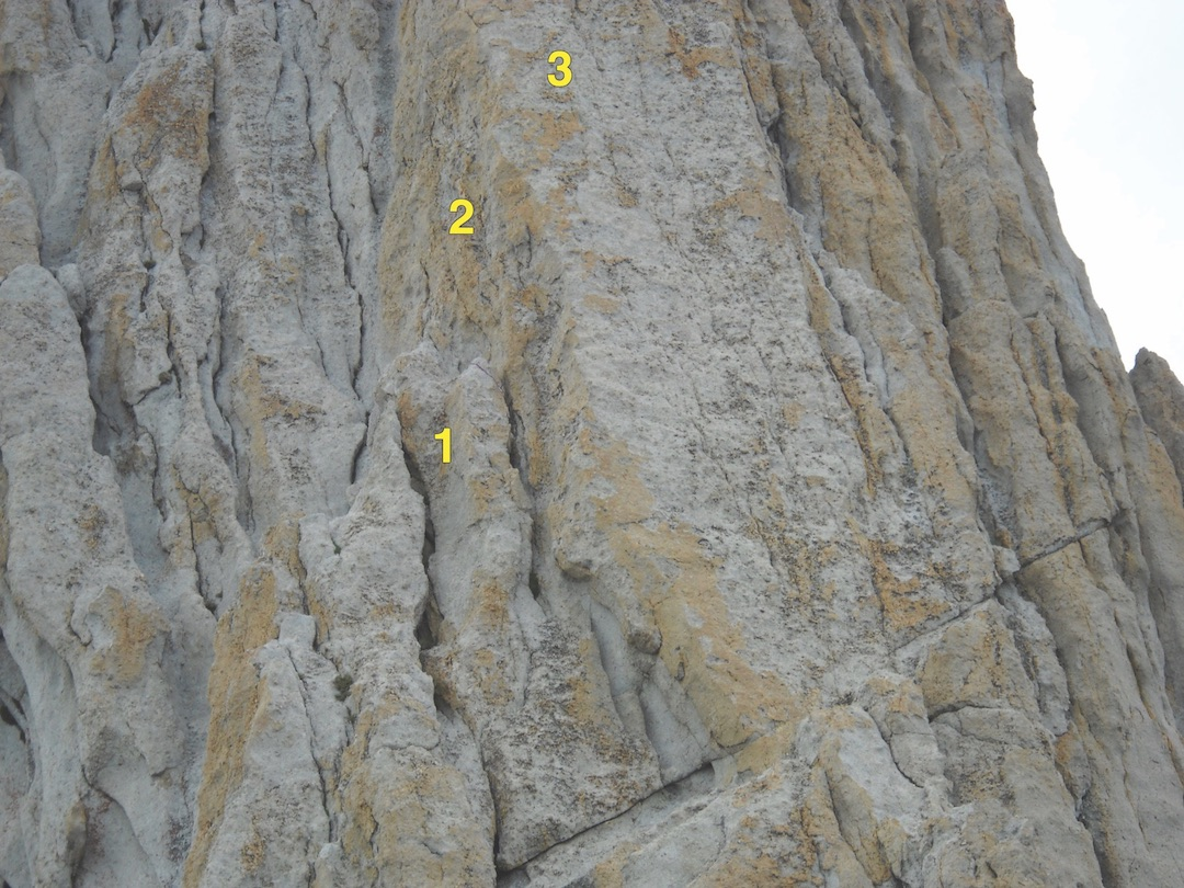 Area above the first belay on Matthes Crest. (1) Belay stance. (2) Leader's only protection (a slung horn). (3) Leader's approximate high point on the right side of a shallow arête, five to ten feet beyond the slung horn. The normal route moves left and up from the belay.