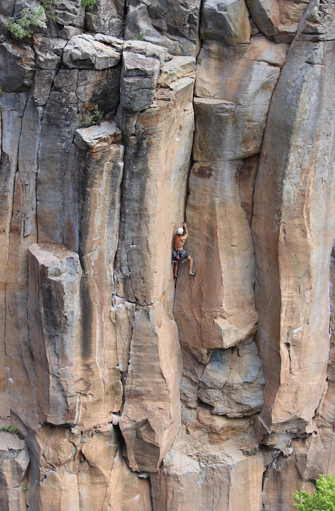 A climber nears the crux of the 5.10+ crack climb.