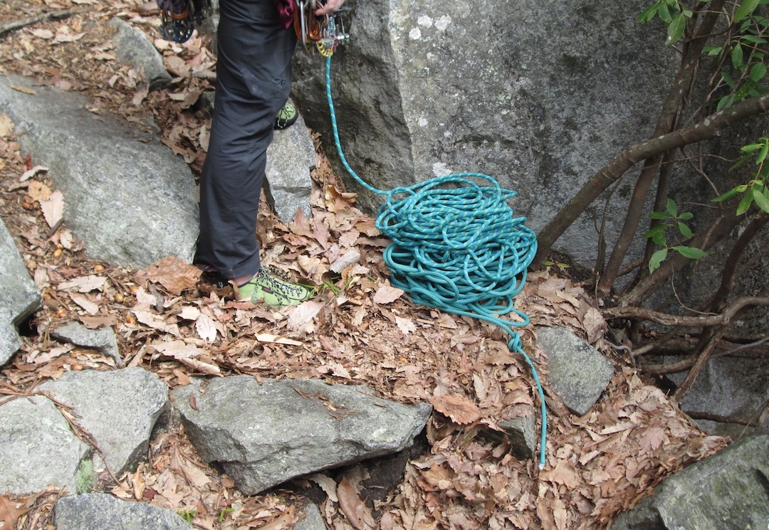 A stopper knot is one of the surest ways to prevent the rope from pulling through the belayer's device while lowering a climber.