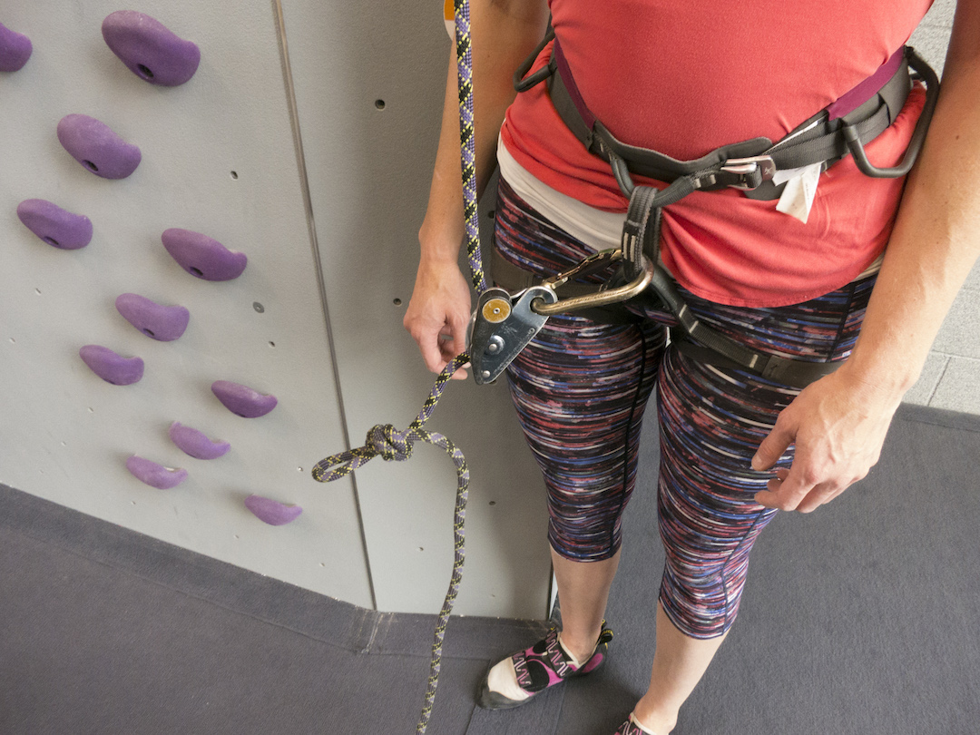 A blocked belay device allows a dynamic tie-in while simul-climbing.