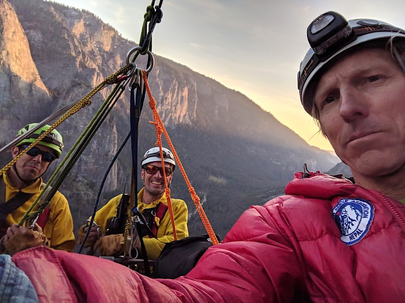 Yosemite rangers Brandon Latham (left) and Philip Johnson, having lowered from the top of El Capitan, arrive at the Gray Ledges to retrieve an injured Hans Florine (right).