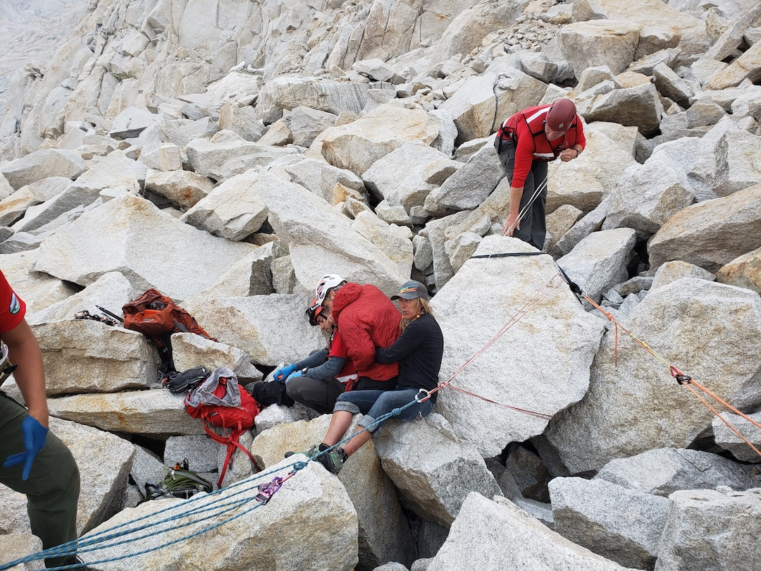 Preparing to move a two-ton talus block from a trapped climber (center, red jacket) below Mt. Conness.