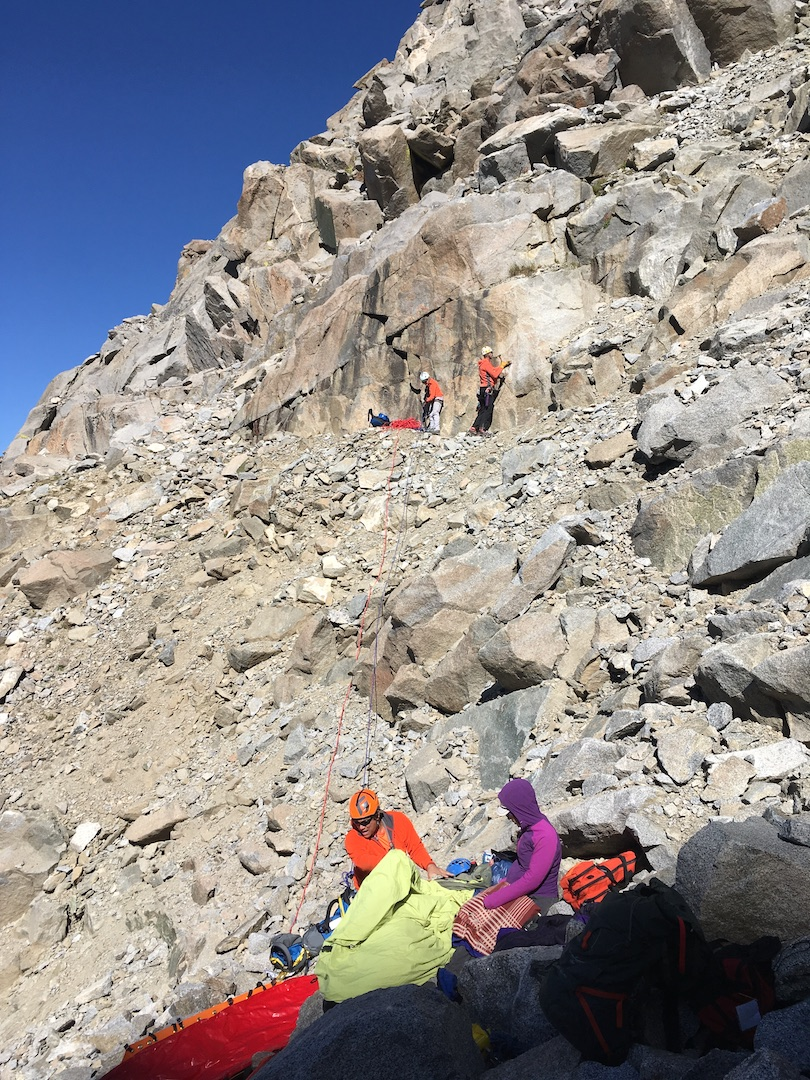Rescuers working to lower an injured climber to a point where he could be picked up by a helicopter.