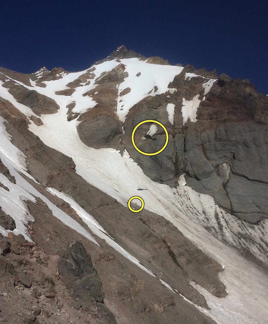Rescue helicopter approaches a climber on Mt. Jefferson after his bivouac with a broken leg.